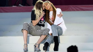 Miley Cyrus (left) and Ariana Grande (right) at the One Love Manchester gig