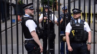 Armed police guard No.10 during an emergency COBRA meeting.