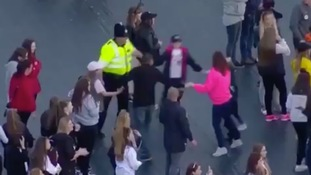 Heartwarming moment at One Love when policeman danced with children
