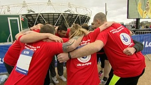 Those taking part in the run at the Olympic Park have a moment to remember why they're there