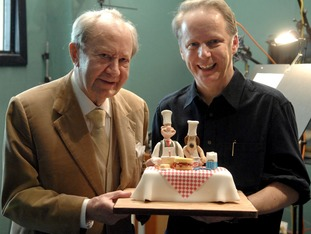 Peter Sallis is presented wit a cake by Wallace and Gromit creator Nick Park.