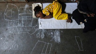 5-year-old Noor Jahan sleeps in a train station in Mumbai