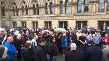 Around 150 people observe the minute's silence in Centenary Square, Bradford.
