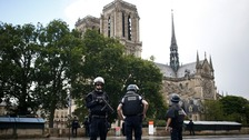 Armed police stand guard outside Notre-Dame Cathedral.