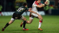 Ulster's Andrew Trimble is tackled by Northampton's Ryan Lamb during the Heineken Cup Pool Four match at Franklins Gardens, Northampton.