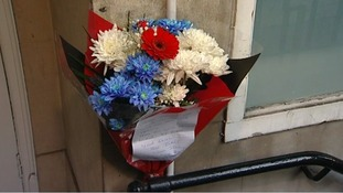 Flowers have been left outside the hospital's nurses' block