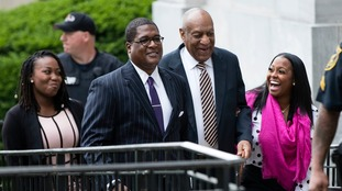 Bill Cosby (second from right) arrives at his sexual assault trial.