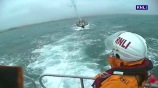 Two rescued after yacht almost washed ashore in winds