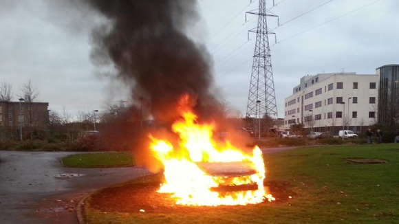 A car on fire in East Belfast during the flag protests.