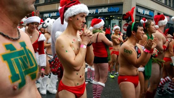 "Participants in the annual ""Santa Speedo Run"" wait at the starting line in Boston."