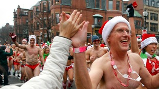 "Participants in the annual ""Santa Speedo Run"" leave the starting line in Boston."