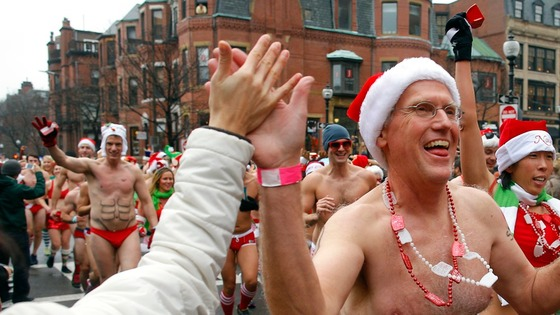 "Participants in the annual ""Santa Speedo Run"" leave the starting line in Boston."