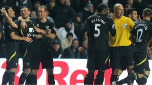 Sebastien Bassong spoke to Howard Webb after celebrating his side's fourth goal in the 77th minute.