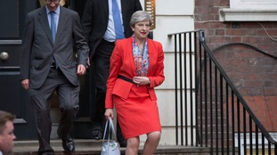 Theresa May leaving her party HQ earlier today