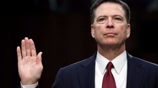 James Comey taking the oath before giving evidence.
