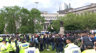 Demonstrators gather in Piccadilly Gardens