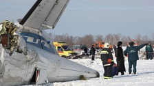 The recovery operation has begun at the crash site in Siberia.