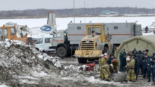 Emergency workers at the site of the plane crash in Siberia.