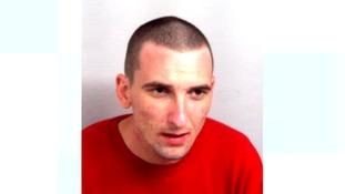 Brett Rogers, double murderer found strangled in his cell.