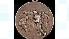 The winner's medal from 1909