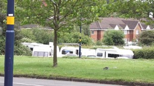 The travellers set up camp on a grass verge off a main road