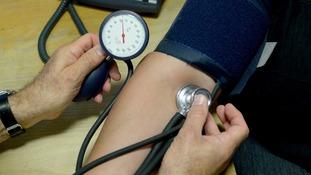Dr taking blood pressure