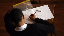 male student taking exam