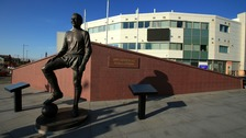 A statue of Jimmy Armfield stands outside Bloomfield Road.
