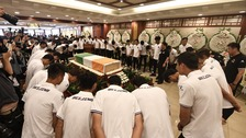 The memorial service took place in Beijing before Tiote's body will be flown to the Ivory Coast for a private funeral