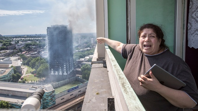 Local resident Georgina stood distraught as she overlooked the Grenfell Tower.