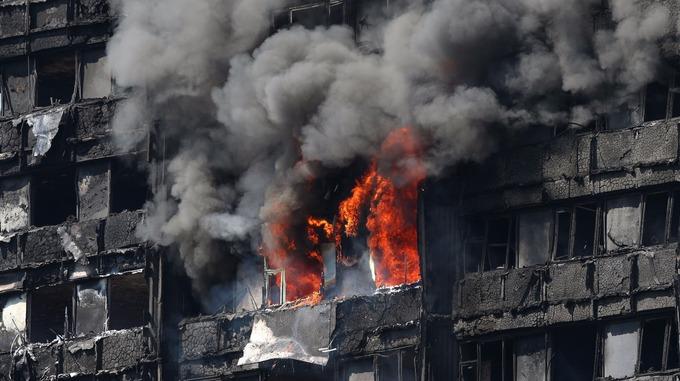 The blaze raged as smoke billowed.