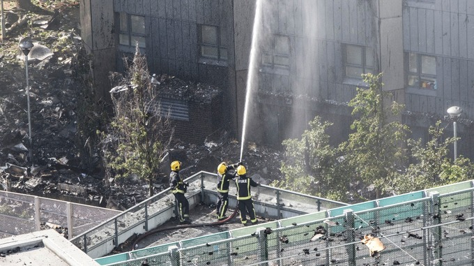 Emergency crews had sprayed water from nearby buildings to try to tame the flames.