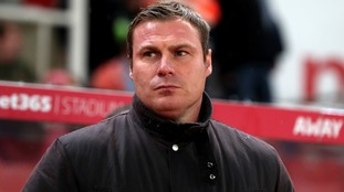 Flitcroft takes charge at Swindon