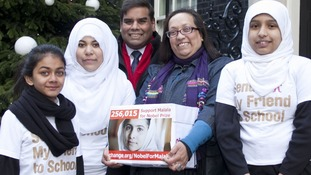 Shahida Choudhry (second right) and Birmingham MP Perry Bar Khalid Mamood deliver a 256,000-name petition to Downing Street.