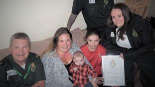 Welsh Ambulance service staff present Shannon with a certificate