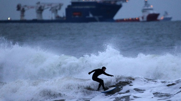 A surfer braves the waters of the North Sea , near Aberdeen