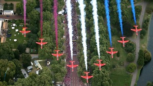 The Red Arrows fly across Queen Victoria Memorial next to Buckingham Palace on September 10