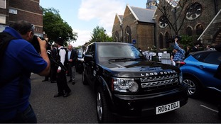 Shouts of 'coward' followed the PM's car