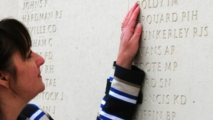 Margaret Allen touches the name of her late husband, Able Seaman Iain Boldy