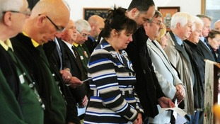 Falklands memorial service is held in the Millennium Chapel at the National Memorial Arboretum in Staffordshire