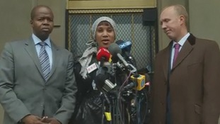 Nafissitao Diallo with her lawyers on the court steps