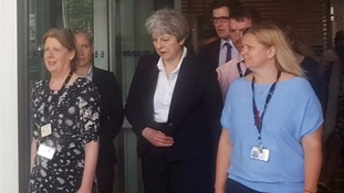 Theresa May leaves a west London hospital after visiting victims