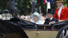 The Queen makes her way down The Mall from Buckingham Palace to Horse Guards Parade for the Trooping the Colour ceremony.