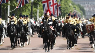 Members of the Household cavalry march on the Mall.
