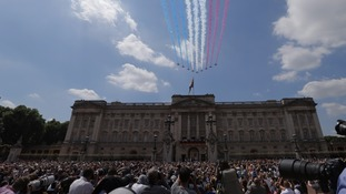 Crowds enjoy a celebratory flypast over Buckingham Palace.
