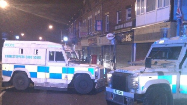 UTV's Jane Loughrey says a patrol car was attacked with iron bars and then a petrol bomb was thrown inside.