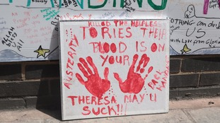 A sign suggesting Conservative austerity contributed to the disaster.