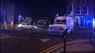 Police were attacked with petrol bombs and fireworks at Broadway, not far from the M1 motorway.