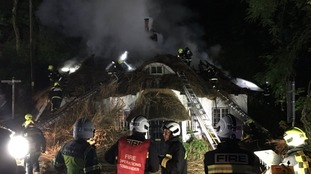 Home severely damaged and roof destroyed after thatch catches fire