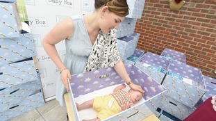 Baby Jasper with mum Farren Webb at the launch of Ipswich Hospital's baby box scheme